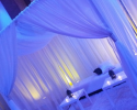 Sheer curtains for draping seating area featuring up-lights and candles to lighten up the mood.